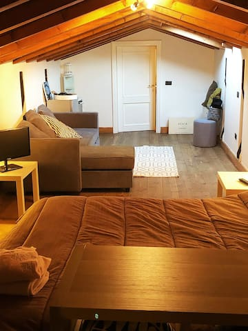 Entering this cosy loft you will find a really comfortable double bed, the couch and in the end of the room the bathroom.