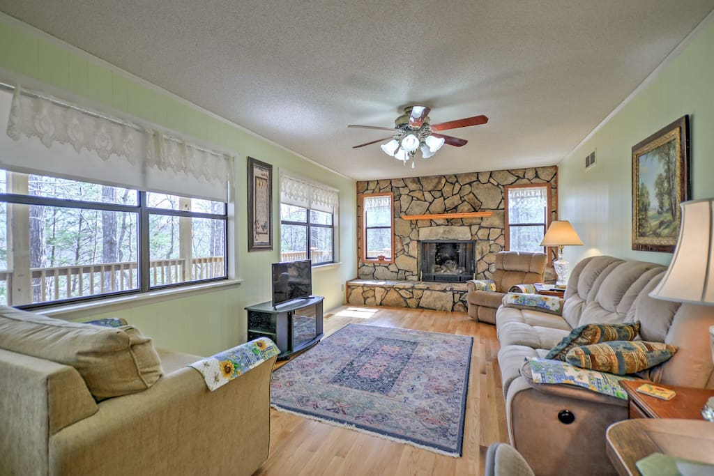 Step into this charming cottage to discover a light and open floor plan with sleek hardwood floors and traditional furnishings.