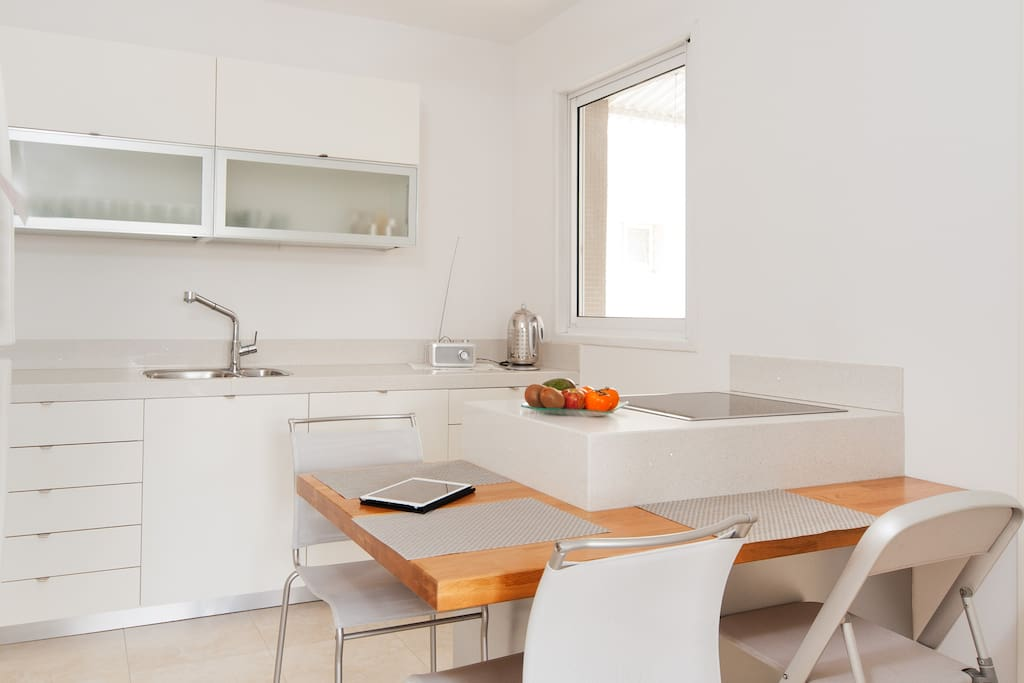 Fully equipped, modern kitchen with  seating area