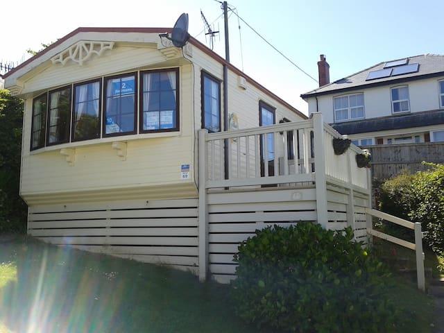 Seaside caravan situated on Bryn Owen holiday park