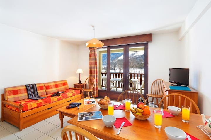 The living area is bright and cozy, perfect for relaxing after a wonderful day.