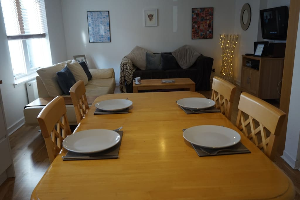 Newly renovated fully integrated open plan kitchen/dining/living area showing new full size double comfy sofa bed and new dining table which seats 6 persons in comfort.