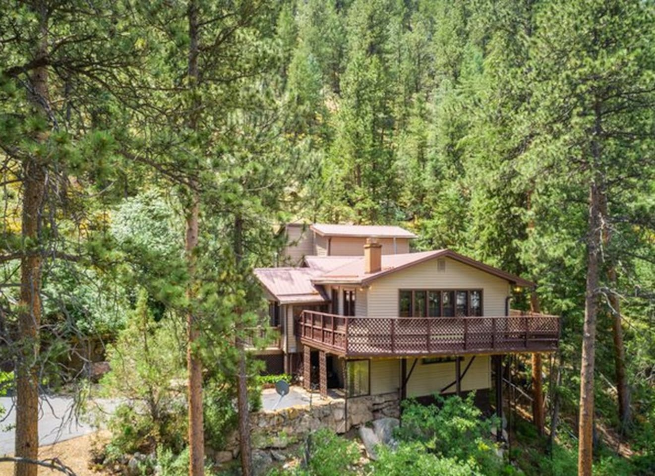 Come enjoy the deck above the Big Thompson River