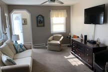 Living room with full size sleeper sofa, large screen cable TV