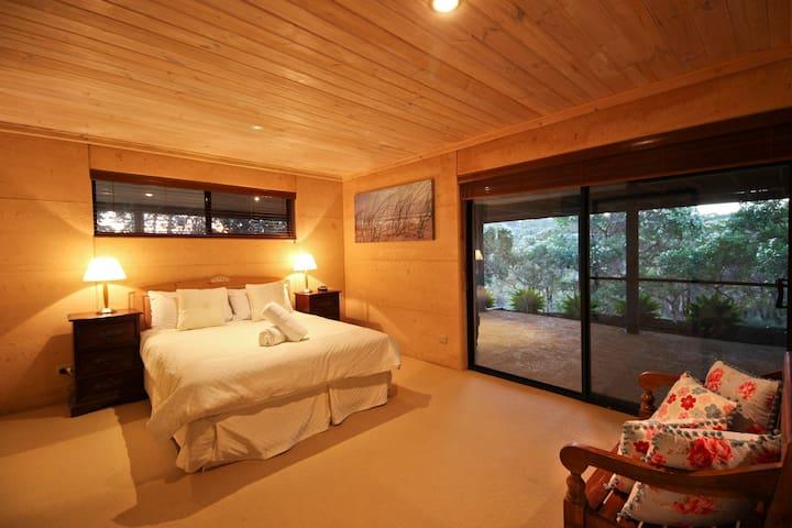 Downstairs bedroom 3 with queen bed