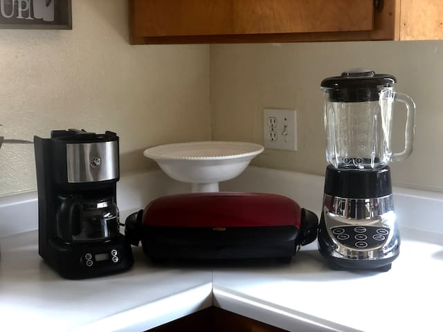In addition to the essentials I have a George Foreman grill, regular coffee maker, and a blender perfect for margaritas or morning protein shakes.