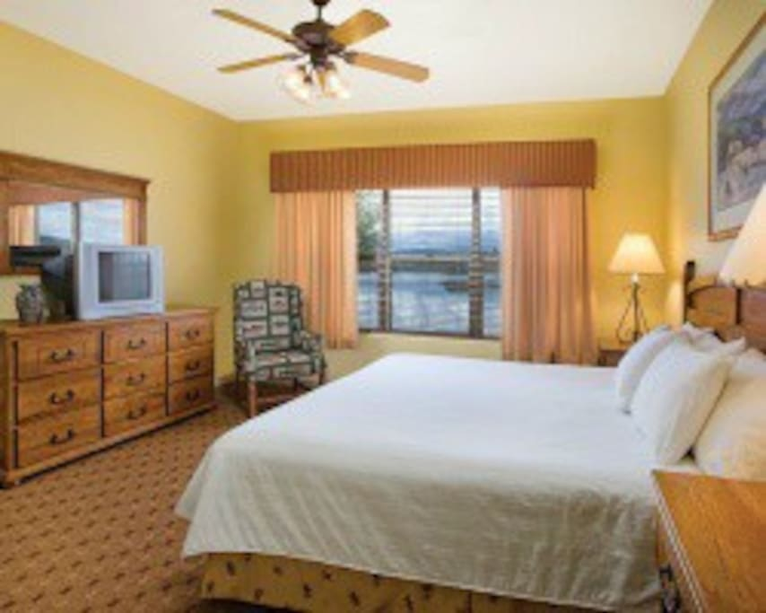 The comfy king-sized bed in the master-bedroom is perfect for a soothing sleep