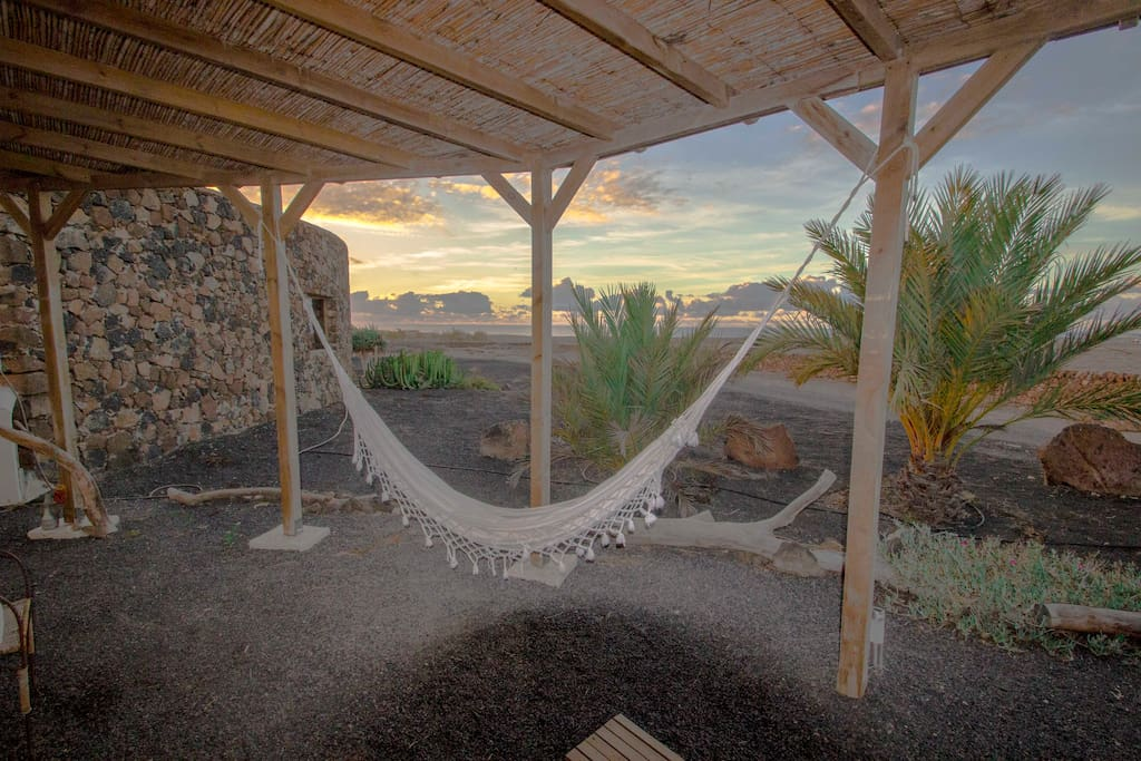 Private northwest terrace with hammock,  sunset and sea view.