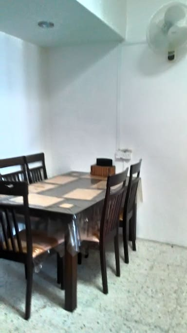The dining area ~ can be used as a dining or a working area. Plug points available. A ceiling fan is provided for this area.