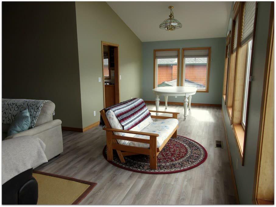 Living-room with second dining area.