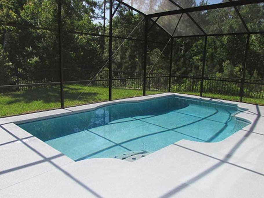 Large private pool with extended deck and conservation view.