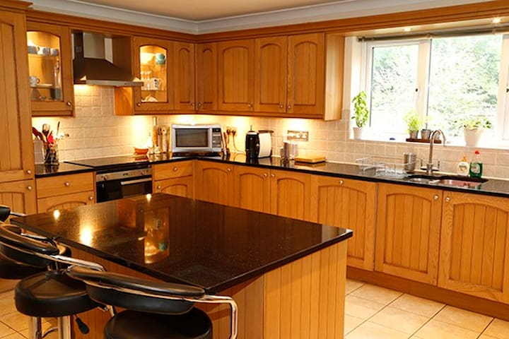 Large kitchen with granite work tops and induction hob and microwave. You are welcome to use the kitchen and lots of fridge and freezer space available for guests.   Room to store food too if you need to.