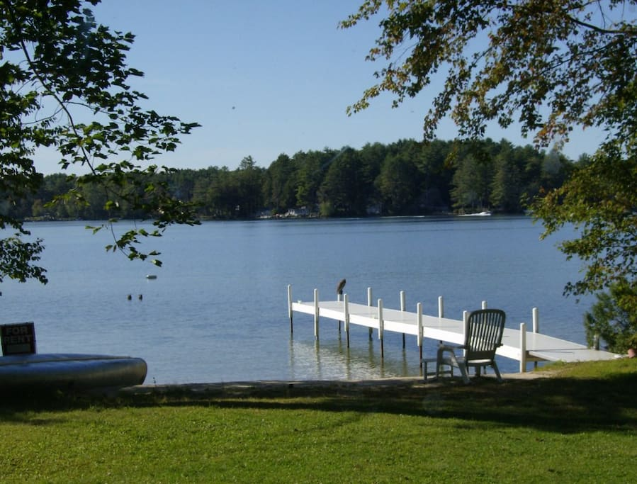 Large flat grassy yard directly on lake with private 35' dock