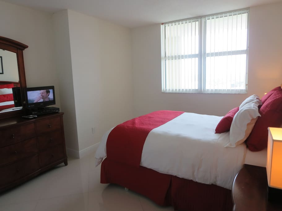 Private bedroom with dresser and flat screen TV