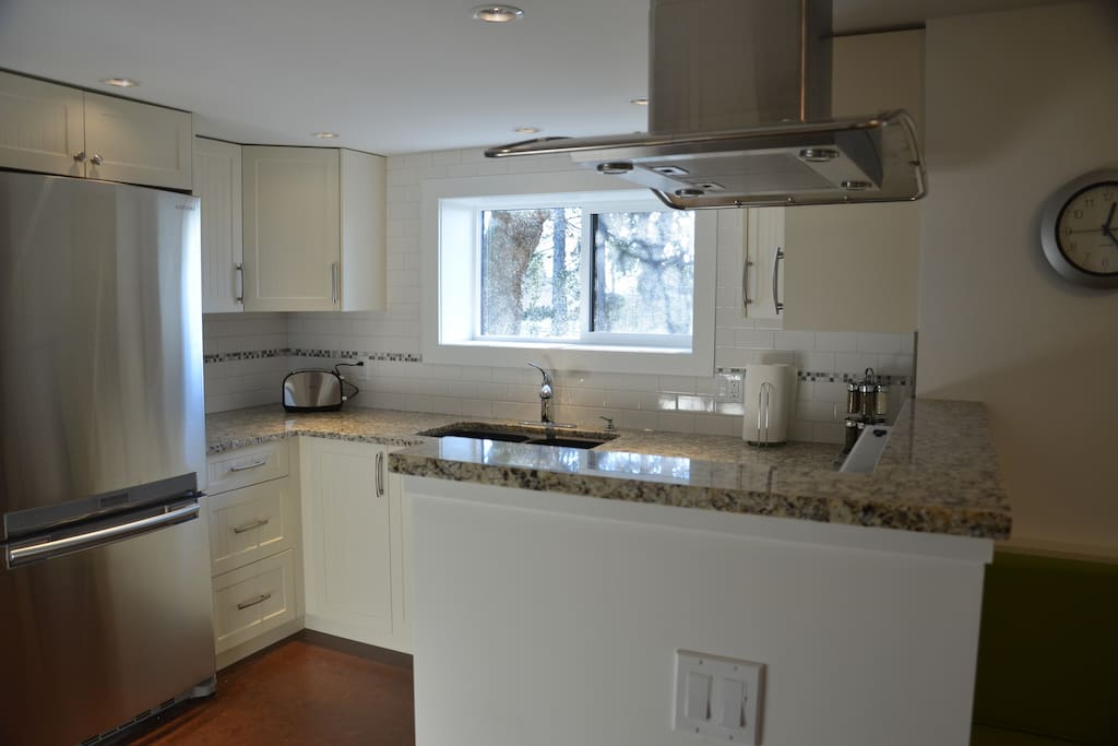 Kitchen with stainless appliances and granite counters