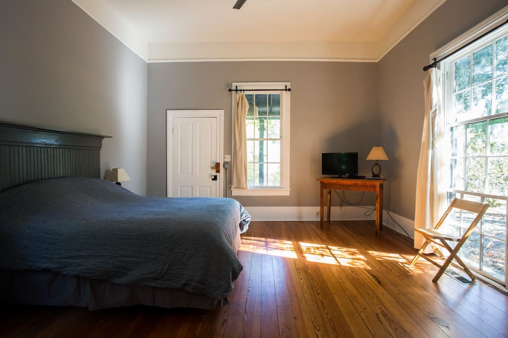 Bedroom with queen size bed. Door leads to front porch.