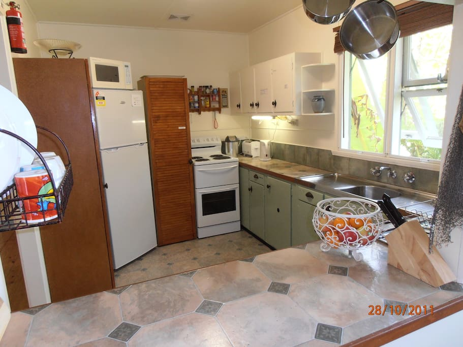 Comfortable,quaint,fully equipped kitchen w dishwasher.