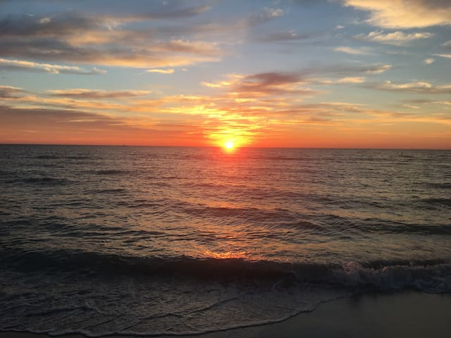 Watch breathtaking sunsets everyday, about 3 minutes walk from the condo