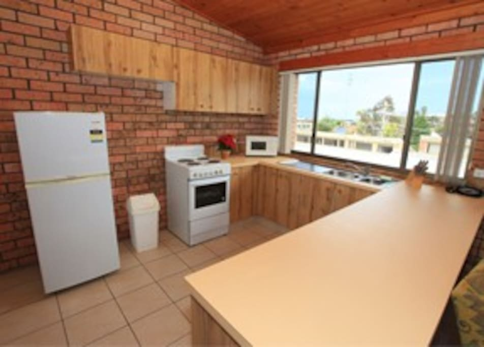 Apartment fully equipped kitchen, full size oven & fridge, microwave, crockery, cutlery, mixing bowls etc