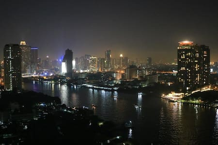 30th Floor 35 sqm Studio Specious Room with River View in Bangkok best location including free WiFi, Large swimming pools & Fitness, Security 24/7. Probably be the most stunning view at the most reasonable price room, especially for the countdown. Near BTS