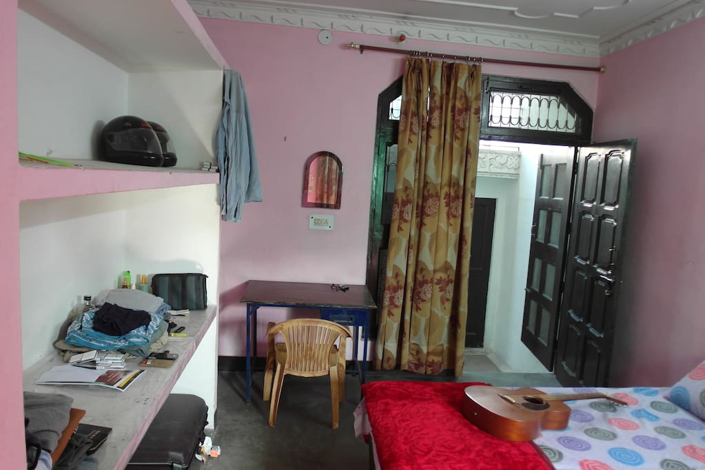 Private Room featuring 2 beds and access to balcony and covered terrace.