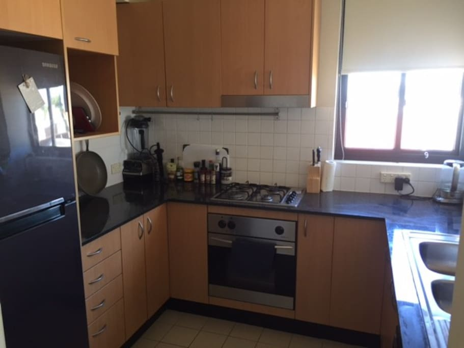 Kitchen with gas hob and kettle that has different boiling temperatures