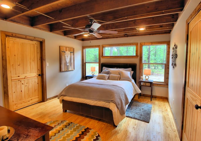 Master bedroom with queen size bed.