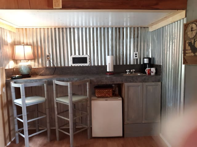 Dorm fridge, microwave, and coffee pot available. Outdoor grill available if you would like to cook.