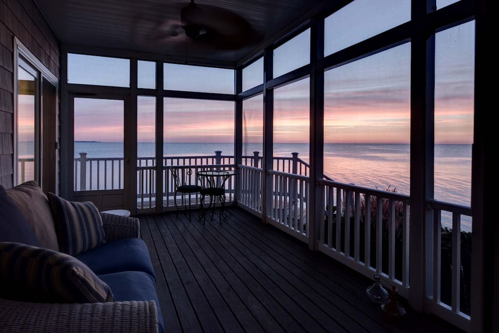 The screened in room of the Main house with views of the Bay