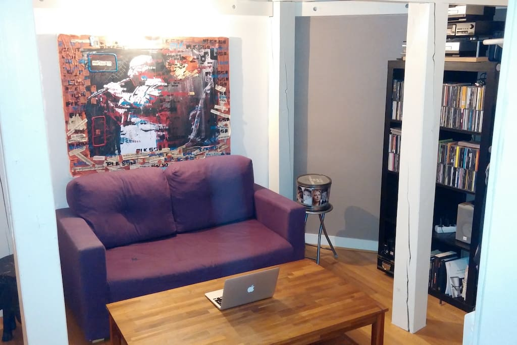 Living-Room with with sofa, wooden coffee table, a hi-fi, good music available :)