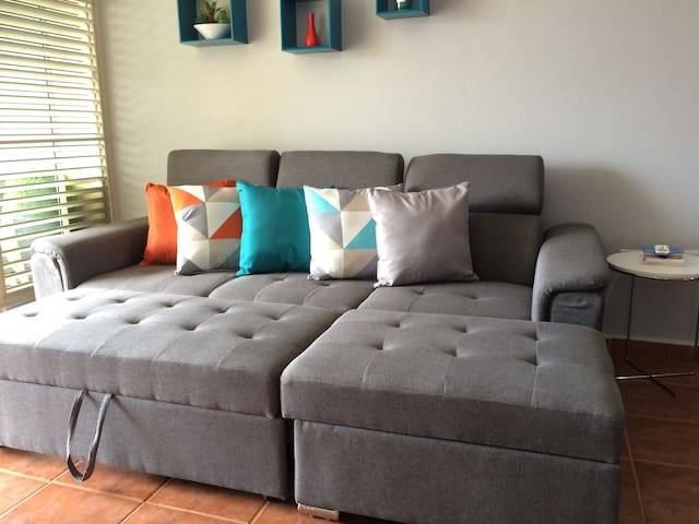 Living room sofa turns into a full bed