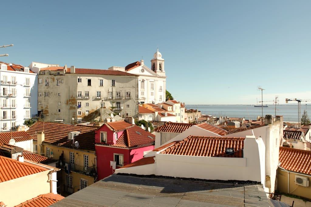 Awesome view facing the river and the Lisbon's traditional roofs