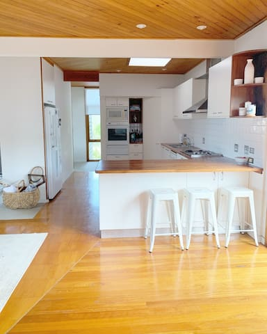 Large and bright kitchen, open plan and great for entertaining. Gas stove, dishwasher. Leading out to the deck and pool area.