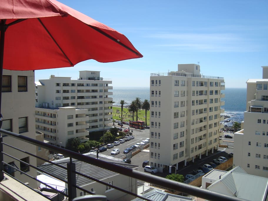 View from the balcony to Rocklands Beach, the Promenade. You can see the Hop On, Hop Off Bus on its way to the nearby stop.