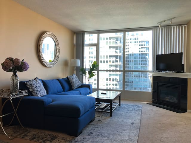 Lux condo next to Convention Center with parking.