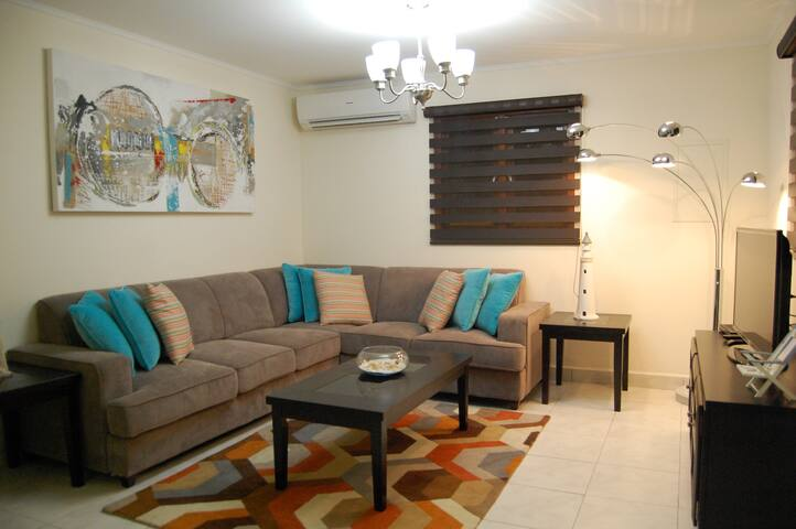 Living room with Sofabed for 2 persons. Flatscreen television.