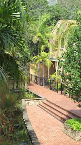 Townhouse 37 is on a walkway with fountains and gardens.
