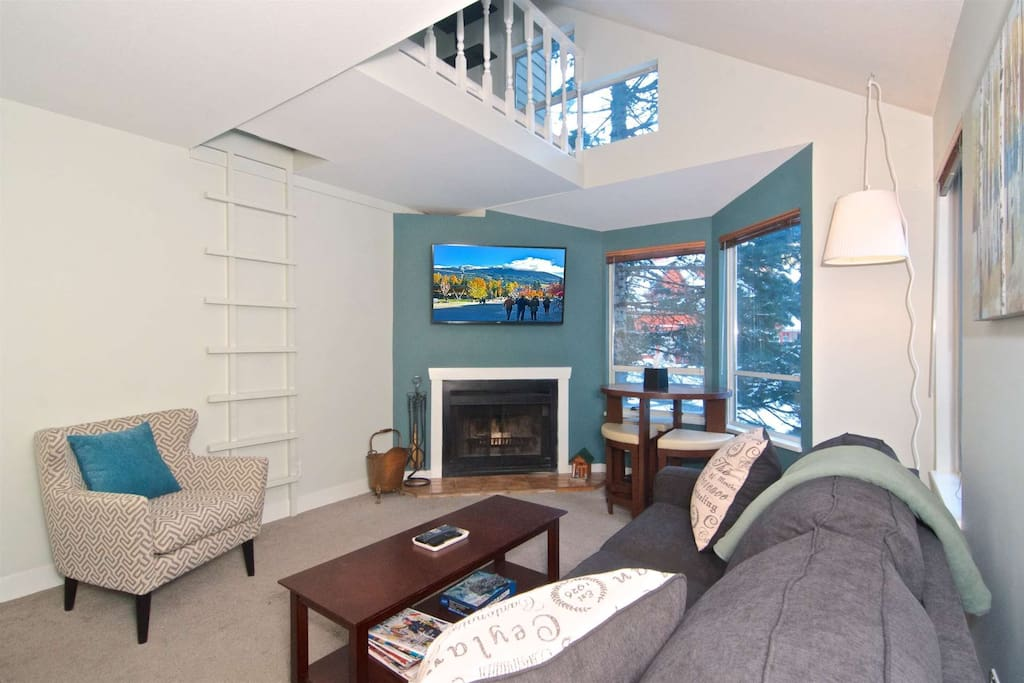 Vaulted ceilings in comfortable living room. 50 inch TV and new furnishings