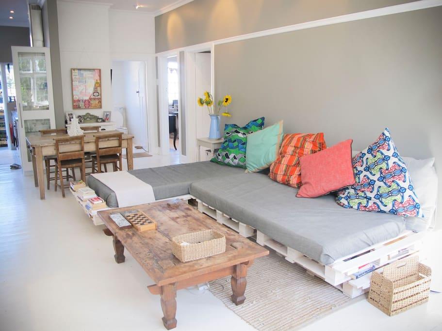 Huga sofa, really comfy. African inspired cushions.