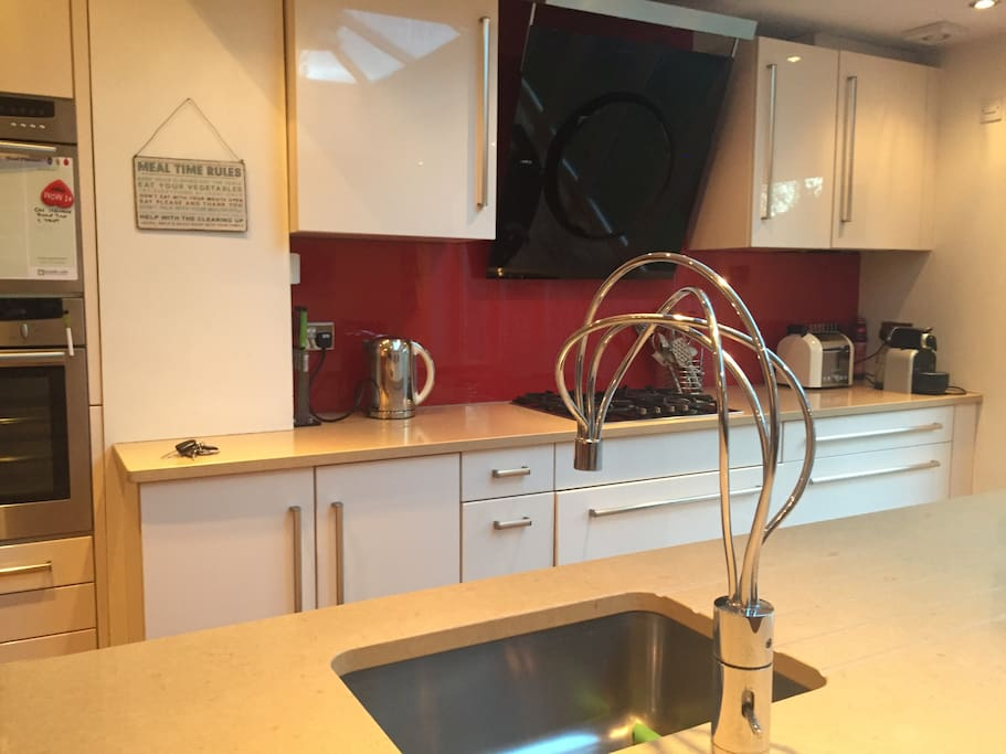 Stare of the art kitchen with designer taps and extractor