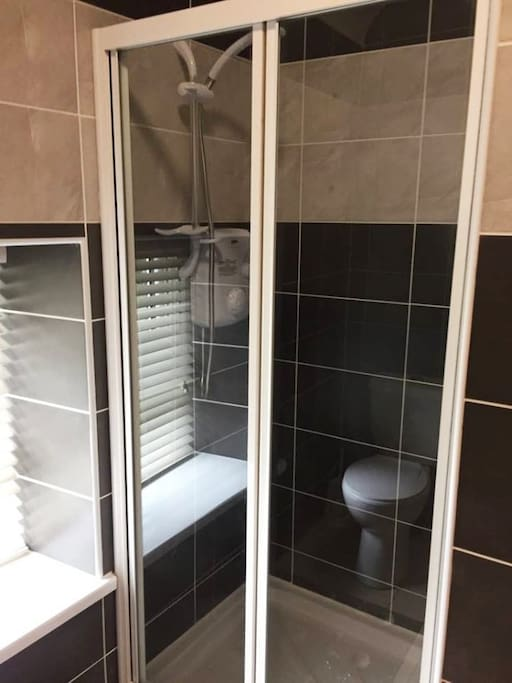 An ensuite shower room connects to one of our double bedrooms