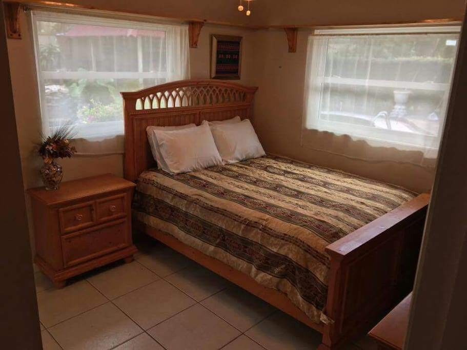 Queen bed.  A very comfortable bed, with two windows overlooking the pool, koi pond and backyard.