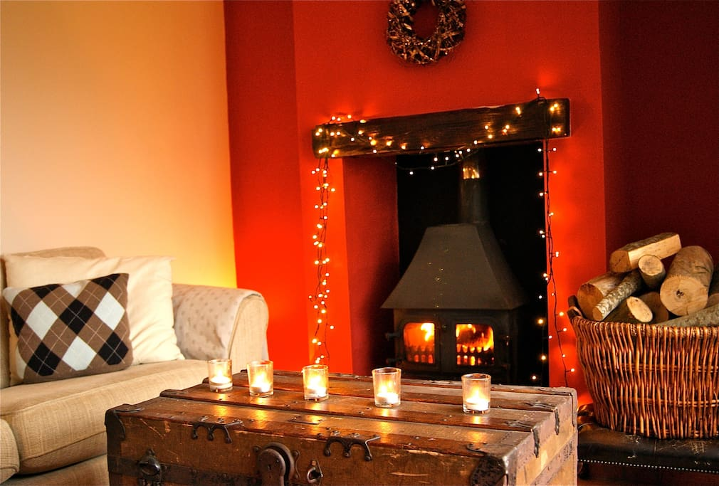 Cozy real log burner.  Lounge area off the dinning area.