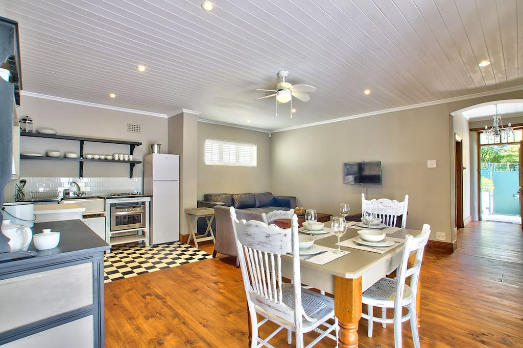 Tv room with DSTV, wifi, dining room with authentic wooden floors newly renovated