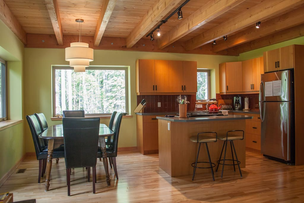 Open concept kitchen and dining.