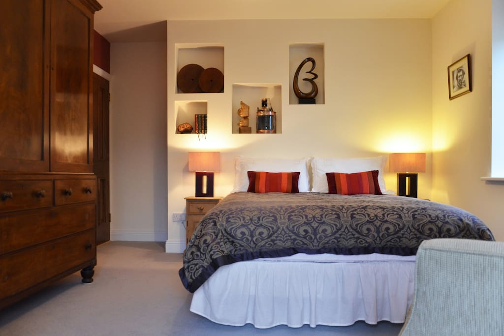 Room 2, offers a 5 foot double bed with a bathroom across the landing.
