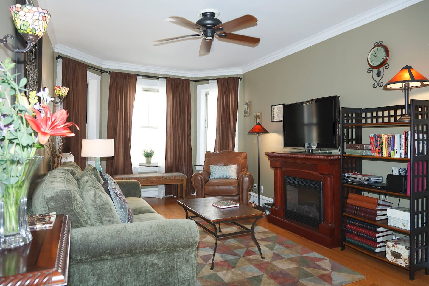 Beautifully decorated living room. The electric fireplace provides a cozy feel.