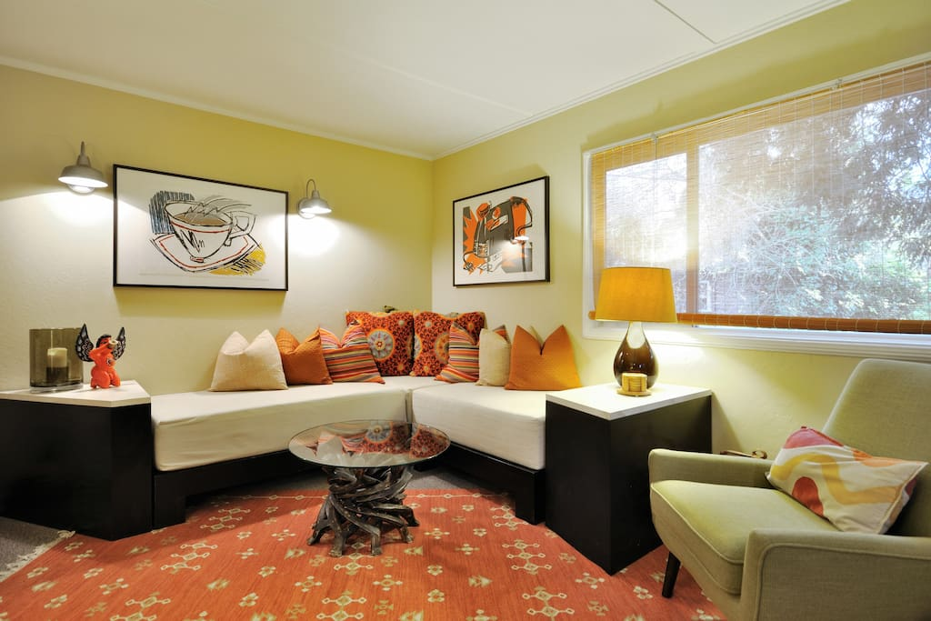 The banquette and 2 easy chairs offer plenty of space to stretch out
