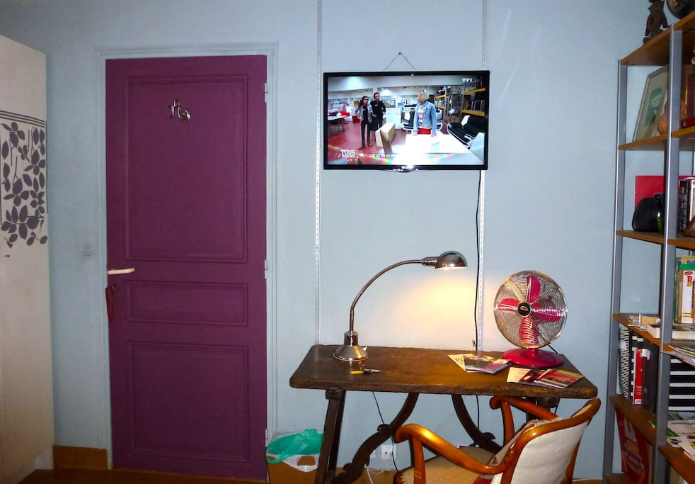 another view of the bedroom with flat TV on the wall