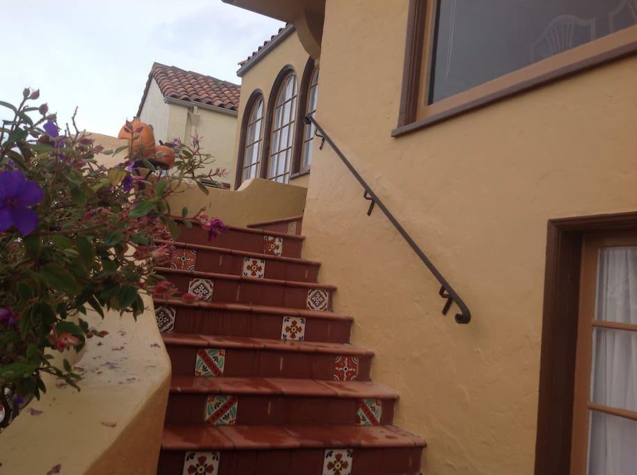Spanish tiles on staircase.